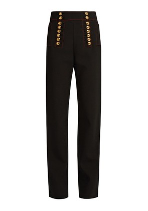 Button-embellished high-rise trousers